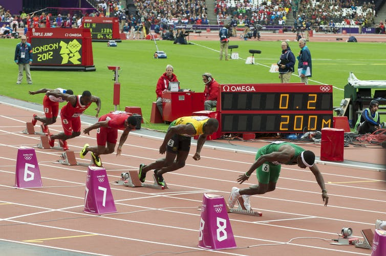 Racers at the starting blocks of a 200m sprint.